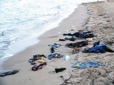 Clothes litter a beach in Bodrum, Turkey, where 11 refugees drowned on Wednesday