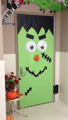 frankenstein halloween door decorations | Frankenstein door w/ pumpkin nose...love this! | Halloween Ideas