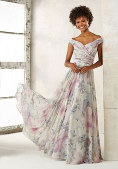 An Off-the-Shoulder Ruched Bodice Perfectly Complements the Flowy Skirt of This Chiffon Bridesmaids Dress Creating a Classic, Elegant Look. Zipper Back. Shown in White Smoke and Eggplant. Available in