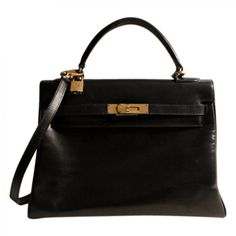 Herm��s Brown Exotic leathers Handbag Constance | Vestiaire ...