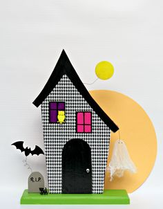 Learn how to make your own 3-D haunted house that glows!