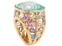 Ring by John Apel. The setting is handmade of 18K rose gold with a huge clean 26.80 carat cushion faceted aquamarine, accented by 0.18 carats of diamonds, and 10 carats of natural pastel sapphires that adorn the basket and shank.