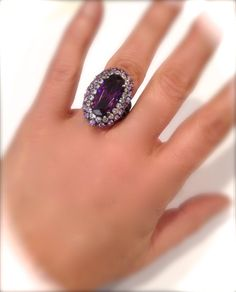 Absolutely Stunning Piece Features A Lush Purple Elongated Oval Center Stone Bordered by a Shimmering Double Halo of Prong Set Rounds In an Elegant Sterling Silver Setting Would Pair Beautifully with Many items in my Shop, Please have a look through the various sections!  Sterling Silver 925 Size 6.25 Ring Ring Measures approx 1 1/16H All Stones CZ Set By Hand In the Tradition of Fine Jewelry.  Thanks For Shopping! Enter My Shop Here For Lots More Vintage and Handmade Goodies: https:&#x...