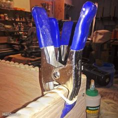 You can buy special woodworking clamps to hold hardwood edging in place until the glue sets, but they're expensive and you won't use them often. Instead of buying specialty clamps, you can modify some of your spring clamps instead. Grab a few rubber bands and presto—instant edge clamps. These clever clamp storage tips help keep your workshop organized.