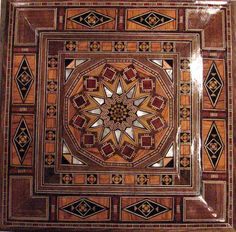 Hand-crafted Syrian wood mosaic box. Inlaid pieces of walnut, olive, lemon and rose woods, and mother-of-pearl.