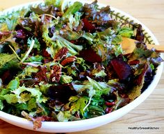 Roasted Beet Salad with Greens and Candies Pecans........Crumble Goat Cheese on top........Fantastic