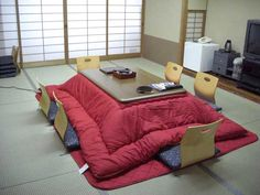 Kotatsu is a heated blanketed coffee table, invented in century Japan, and can be found in most Japanese homes during the winter. While they are the focal point of Japanese homes during the winter, they usually arent the prettiest furniture. Japanese Interior Design, Japanese Home Decor, Asian Home Decor, Japanese Table, Japanese House, Japanese Furniture, Oriental Furniture, Contemporary Home Decor, Deco Design