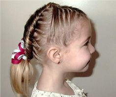 Children hairstyle updo with braids