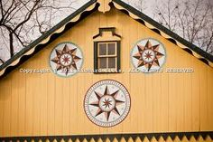 Amish Style Barn with Hex signs. These are beautiful and Hex signs does not refer to something bad. They each have a meaning. I have one of a horse on my barn. The meaning of the horse is protection for animals. I love them!! Back in the day traveling thru the country you would find these on most barns.
