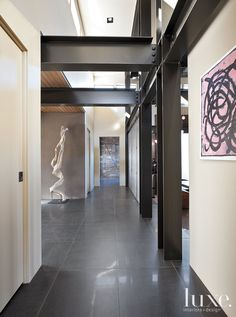 Steel beams were left exposed in this #Washington home's formal #entry for a #contemporary look and feel.