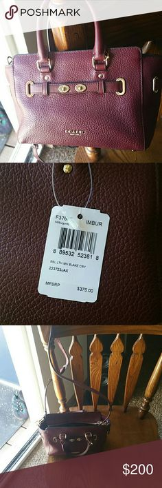Coach purse New never used burgundy color Coach Bags Mini Bags