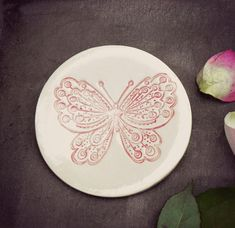 A personal favourite from my Etsy shop https://www.etsy.com/listing/99898923/rustic-butterfly-ceramic-plate-white