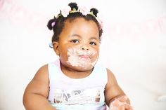 This cake smash photography session was for Athi at one year old. She loved getting all messed up and covered in chocolate for us!