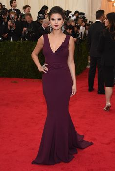 Pin for Later: 50+ Iconic Met Gala Dresses Worn by Latinas Selena Gomez For her first Met Gala appearance, Selena impressed in an eggplant Diane von Furstenberg gown.
