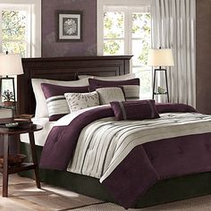 Transform your bedroom into a luxurious boudoir with the Madison Park Palmer 7-Piece Comforter Set. The plush comforter features grey and brown pieced micro suede on a plum background for a lavish look.