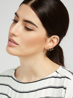 A pair of ear cuffs decked in black diamonds is edgy and luxe. The fishhook is adjustable and can be loosened for application and tightened to preference once on.