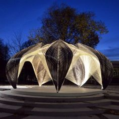 Intriguing pavilion built to research load-bearing capacity and complex layers of a structure based on a lobster's exoskeleton.  A robot wound resin-saturated glass and carbon fiber around a steel structure to build the pavilion.