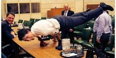 Justin Trudeau Planking On A Desk