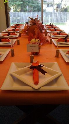 Thanksgiving table setting. Made paper plates and plastic silverware look fancy.