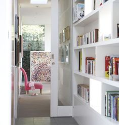 Make the most of an oft-ignored space by using a hallway for storage. These bookshelves serve as decoration and a makeshift library.