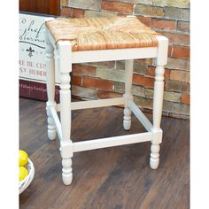 Go with a modern theme for your bar or dining room with this antique-white 24-inch counter stool. You'll enjoy the comfortable woven rush seat, and the study Asian hardwood frame makes this stool durable. The geometric accents add additional detail.
