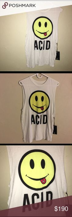 UNIF ACID TANK Literally new with tags, and UNWORN. This is an extra small.  UNIF ACID Tank. Muscle T. Top. Smiley face with tongue sticking out with UNIF LOGO strip on tongue. Distressed muscle tank. My fiancé bought me this along with a ton others, but i never get around to wearing this one. So trying to let it go for the right price. Thnx for under understanding and I will take offers also... UNIF Tops Muscle Tees