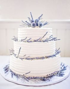This cake is as budget-friendly as it is beautiful! The couple opted for dried flowers over fresh ones, using sprigs of lavender and globe thistle to pretty up a simple buttercream confection. | Photo by Rachel Havel
