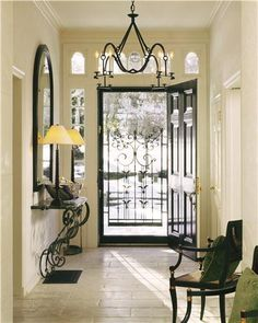 Light Transitional Foyer by Tim  Button