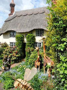 Thatched Cottage with wooden garden ornaments, Market Bosworth, Leicestershire, England All Original Photography byhttp://vwcampervan-aldridge.tumblr.com