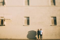 Outdoor engagement photo standing by white brick building at sunset - Photo by Grant Daniels Photography Outdoor Engagement Photos, Engagement Pictures, Steel City Pops, Wedding Thanks, Brick Building, Sunset Photos, Mr Mrs, Engagement Photography, Getting Married