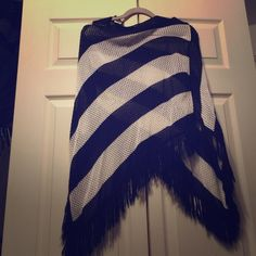 Black and white striped poncho This poncho is great on a cool spring or summer evening as a cover up. You can wear it with some boyfriends jeans, a tank top and some too cute sandals. I can certainly see you in that outfit, you better work it!!!  Tango Sweaters Shrugs & Ponchos
