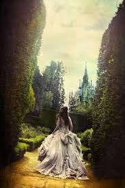 this is an image of a girl wearing a long dress who is walking towards the tower