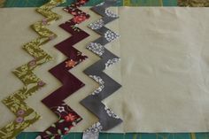 A fun way to make chevron strips with applique. there is also a great ruler that marks that for you #quilting