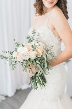 Rose and greenery wedding bouquet: Photography: Rhythm Photography - rhythm-photography.com Read More on SMP: http://www.stylemepretty.com/canada-weddings/2017/04/25/rose-quartz-crystals-wedding-inspiration/