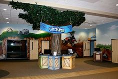 Worlds of Wow - Parents use self check-in around this sculpted tree that fits into the wall theming at The Worship Center in Lancaster, PA. #kidmin #children #kids #ministry #theming
