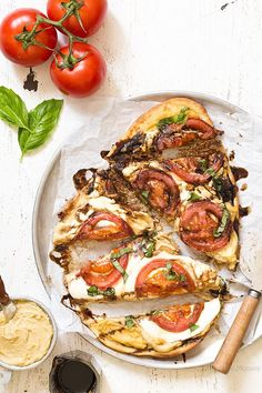 Looking for something quick and fresh to eat? Try this Caprese Hummus Flatbread Pizza with fresh tomatoes, sliced mozzarella cheese, basil, and balsamic vinegar. Made with @sabradips