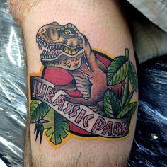 f4a4a2f98abaa 40 Adorably Ferocious Jurassic Park Tattoos