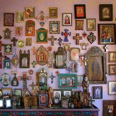 Suzi's religious folk art wall in the room she calls The Goddess Room - Power of Adornment Power of Adornment