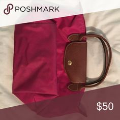 Small Longchamp purse Gently used, bottom corners are a little worn looking, but other than that the bag is in great condition! Longchamp Bags Mini Bags