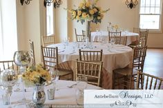 low and tall centerpieces with yellow wedding flowers by Antebellum Design