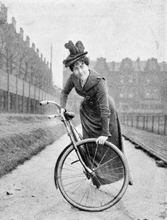Woman performing a bicycle stunt at Queen's Club, 1901.