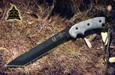 Cutting: TOPS Knives Anaconda Tanto Point Knife.   DESIGNED BY RON HOOD OF 'HOODS WOODS' THIS KNIFE HAS BEEN AROUND THE WORLD AND PROVEN ITSELF FROM THE AFRICAN JUNGLES TO THE ALASKAN FRONTIER...ITS UNIQUE DESIGN ENABLES THE USER TO ENHANCE THE DOWNWARD STROKE OF THE KNIFE BY THE ANGULAR RELATIONSHIP TO THE STURDY HANDLE.   RON HOOD'S EXPERIENCES HAVE MADE HIM A HIGHLY RESPECTED AUTHORITY IN THE SURVIVAL COMMUNITY, WORLDWIDE. HIS EXPERIENCES HAVE ENABLED THE 'ANACONDA' DESIGN, TO BE A 'FIELD...