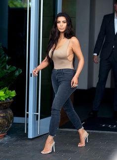 Kim Kardashian in a nude bodysuit and black skinny jeans