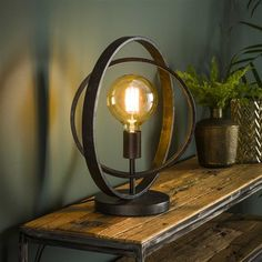 This industrial table lamp has a single light source, is made of metal and is finished with a charcoal touch. The light source distributes the light in a beautiful way through the room, creating a great ambiance. Table Lamp Wood, Black Table Lamps, Glass Table, Desk Lamp, Modern Industrial Decor, Industrial Table, Lampe Steampunk, Free Standing Lamps, Industrial Ceiling Lights
