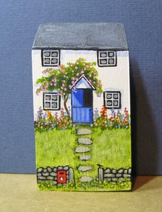 A delightful country cottage with a garden full of flowers and a post box by the gate, very handy for those special letters. Made of wood and hand painted using acrylics. The piece measures 3 tall and 1 3/4 wide, it is signed on the back.