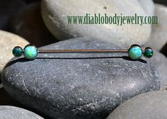 Industrial Strength Titanium Forward Facing Gemini Barbell with Lime Green and Black Opal Bezel Gems. Industrial Barbell