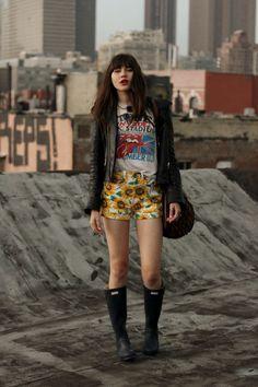 Sunflower Showers b @natalie Suarez wearing @truereligion jacket, @American Apparel shorts, @jenny bird bag, @hunter boots.