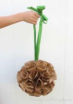 Create beautiful paper flowers from brown paper bags! Perfect Spring craft for kids, or Mother's day craft SavingSaidSIimply.com