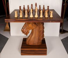 A unique and fanciful knight chess table in rosewood, the top is supported by a mahogany pedestal carved in the form of a horse's head that rests on a square base, after William (Billy) Haines. Table Legs, A Table, Knight Chess, Chess Set Unique, Chess Table, Chess Pieces, Table Games, Game Room, Planer