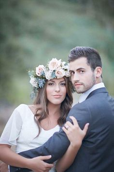 Love her flower halo and their pose. A flattering photography pose for your wedding portraits. Captured by @bleudogfoto